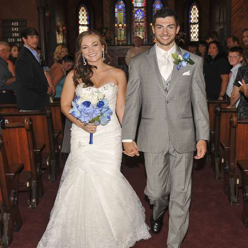 picture of bride and groom walking down aisle