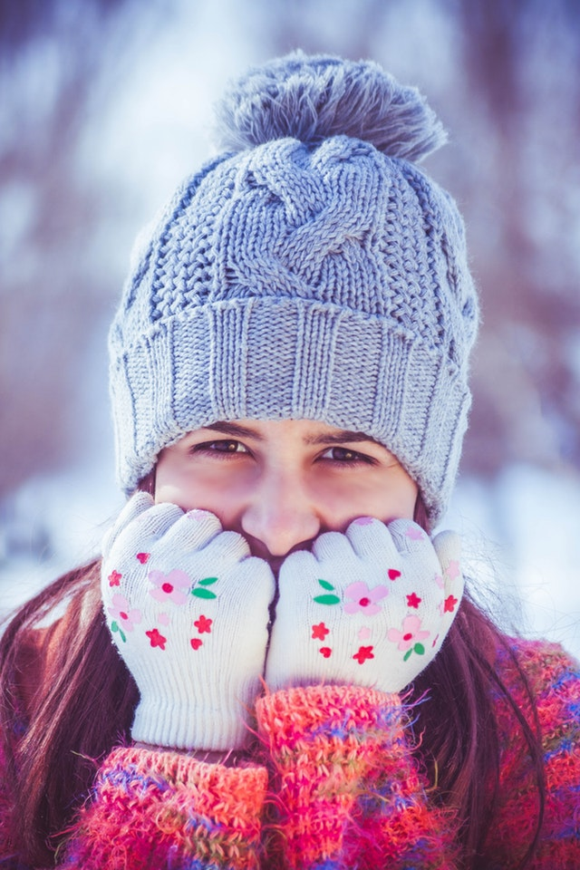 picture of smiling girl with hat and gloves on